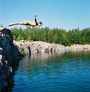 Guy Diving Off Cliff